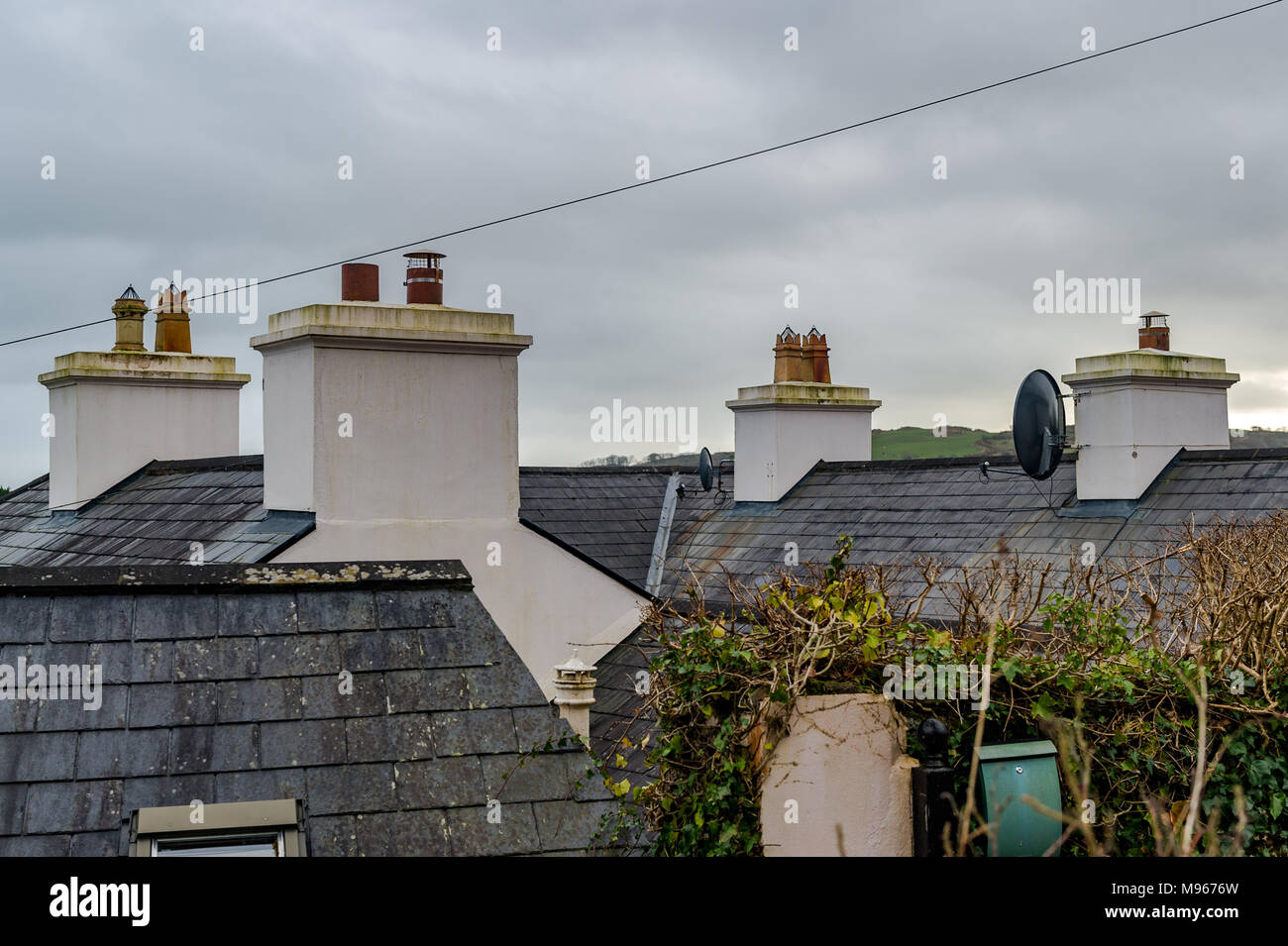 Chimney pots and roofs of houses in West Cork, Ireland with copy space. - Stock Image