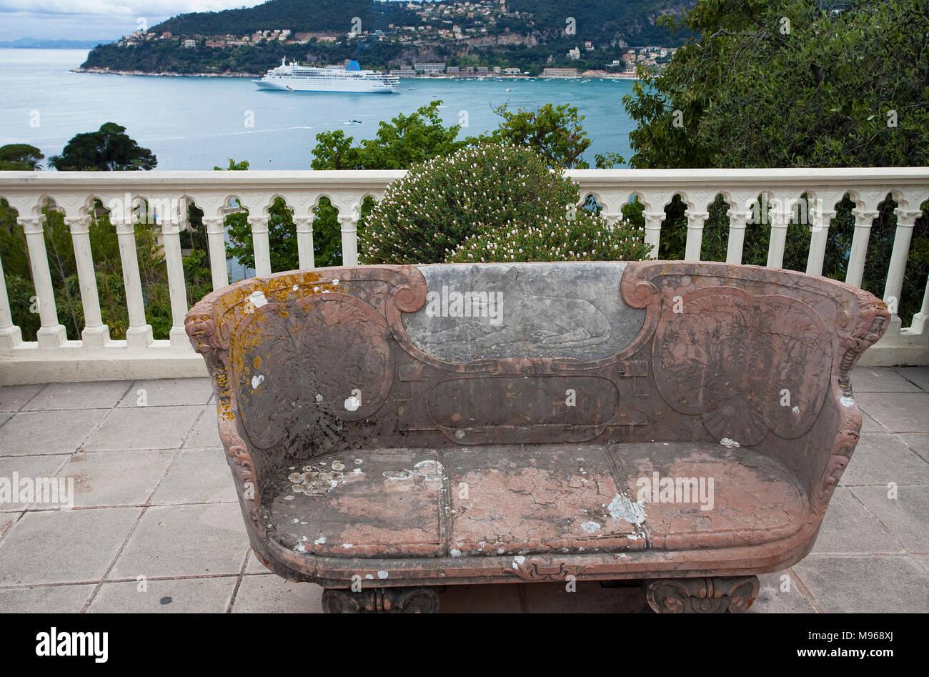 Ancient bench at garden of Villa Ephrussi de Rothschild, tuscan architecture at Cape Ferrat, South France, Var, Cote Azur, France, Europe - Stock Image