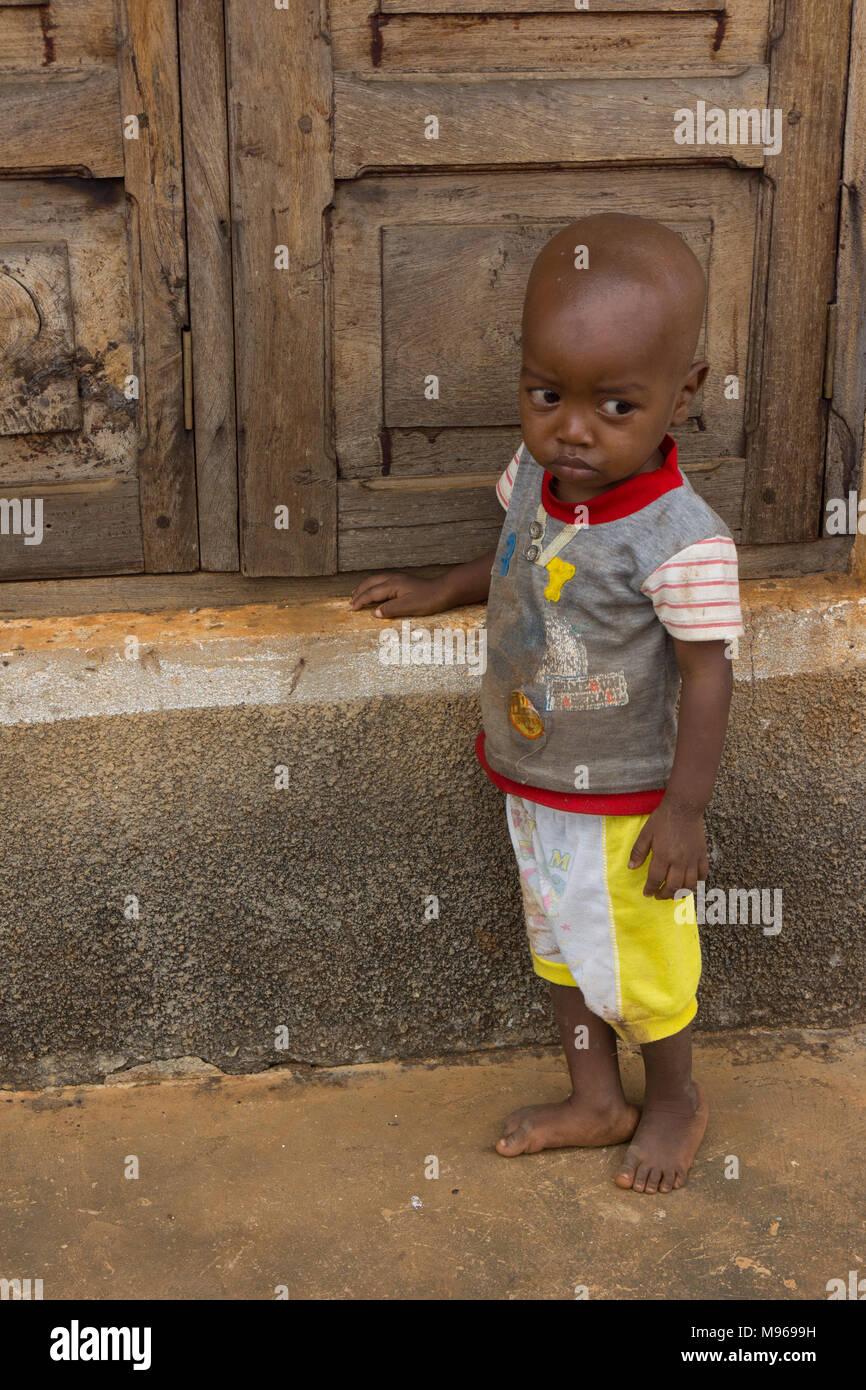 Shy young boy looking sad in Zanzibar - Stock Image