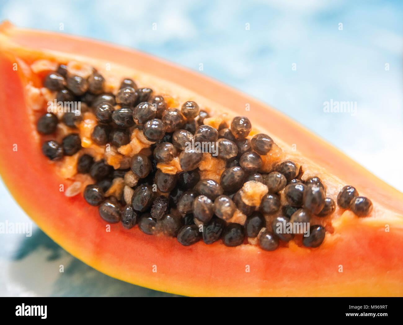 Cut slices of papaya with seeds. Macro mode - Stock Image