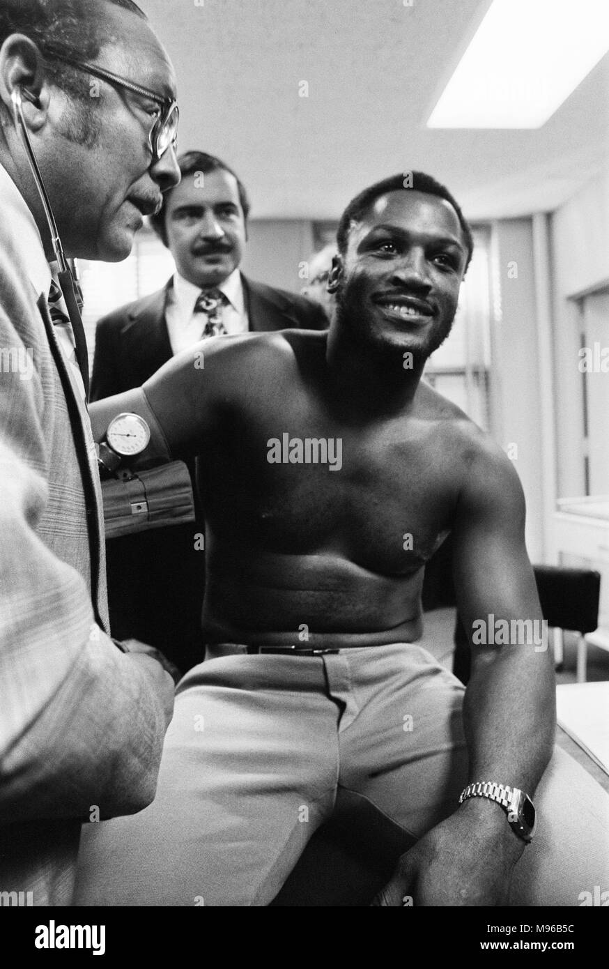 Super Fight II was a non-title boxing match between Muhammad Ali and Joe Frazier. The second of the three Ali vs Frazier bouts, it took place at Madison Square Garden in New York City on January 28, 1974. Ali was a slight favourite to win, and did by a unanimous decision. (Picture) Joe Frazier having a pre-fight medical for 'Super Fight II.' - Stock Image