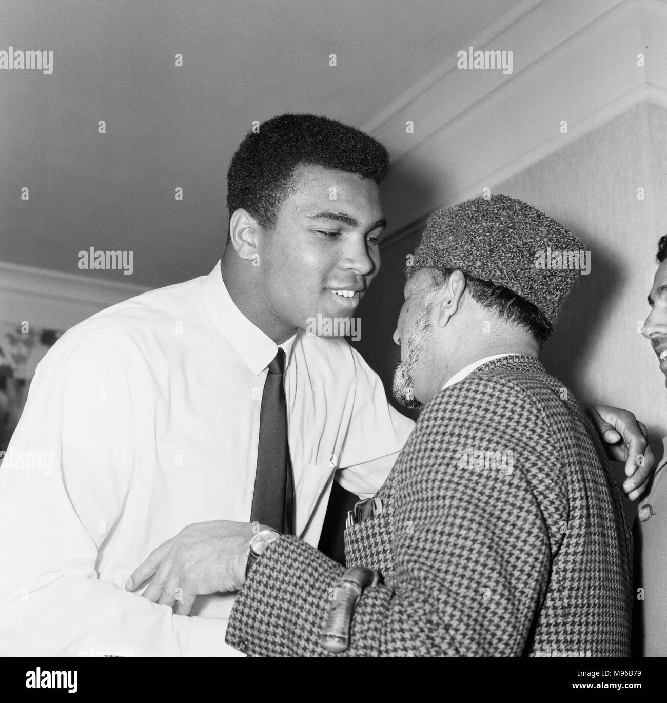 Muhammad Ali (Cassius Clay) greeting muslims at a public speaking about Islam. Ali is in London for of his rematch with British Heavyweight Henry Cooper to be held at Highbury Stadium. 20th May 1966. - Stock Image