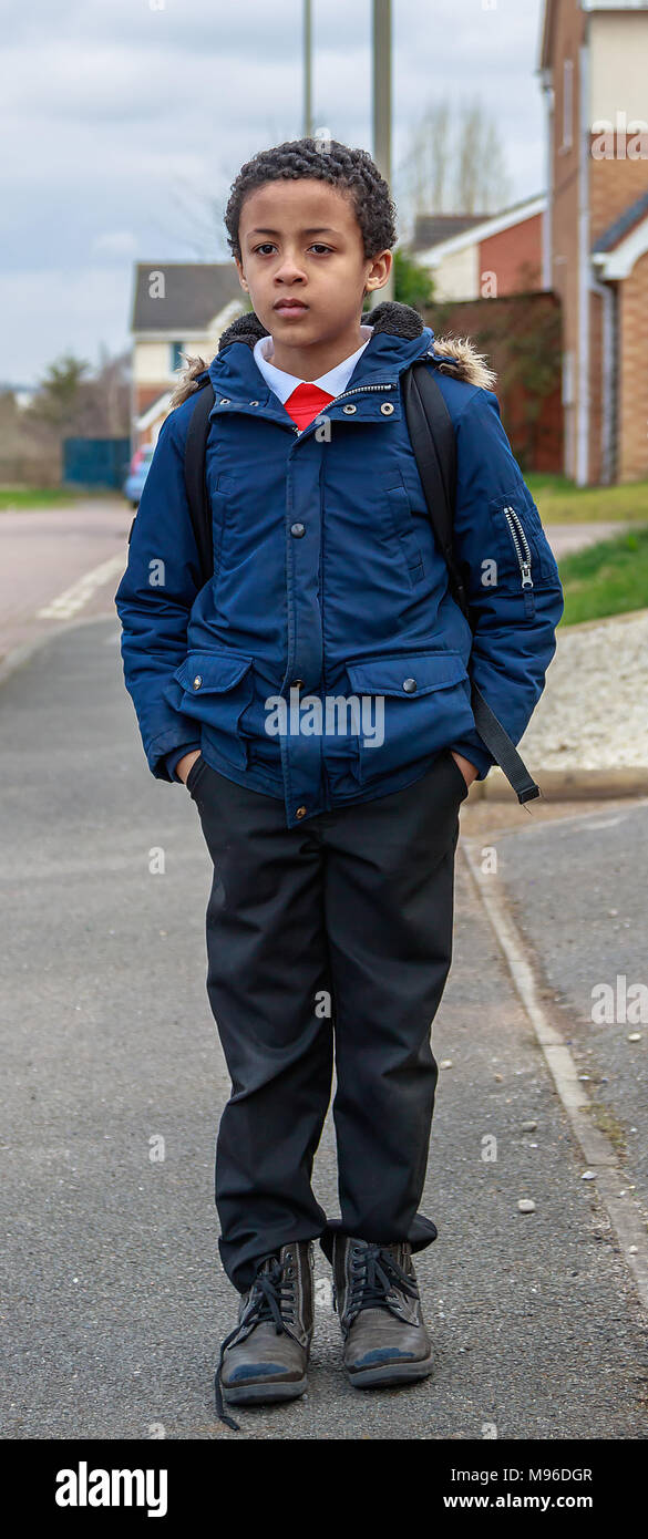 Young School Boy Walking Home From School In Leicester, United Kingdom - Stock Image