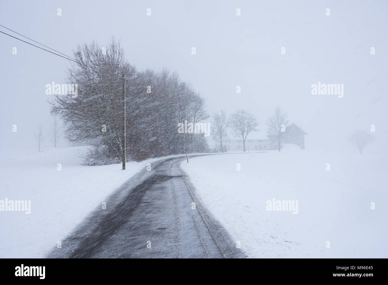 Snowstorm on highway in Bavaria Stock Photo