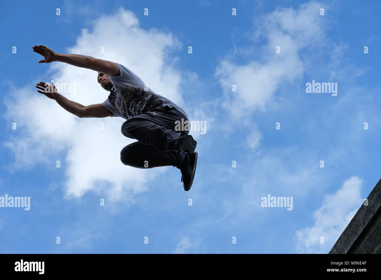 Parkour jumping on the South Bank, London - Stock Image