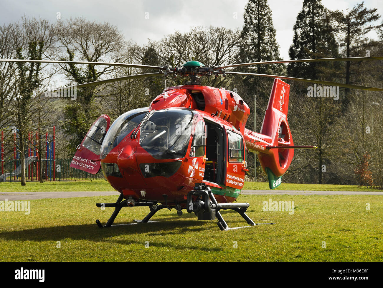Airbus helicopter of the Wales Air Ambulance service on the ground during an emergency mission Stock Photo