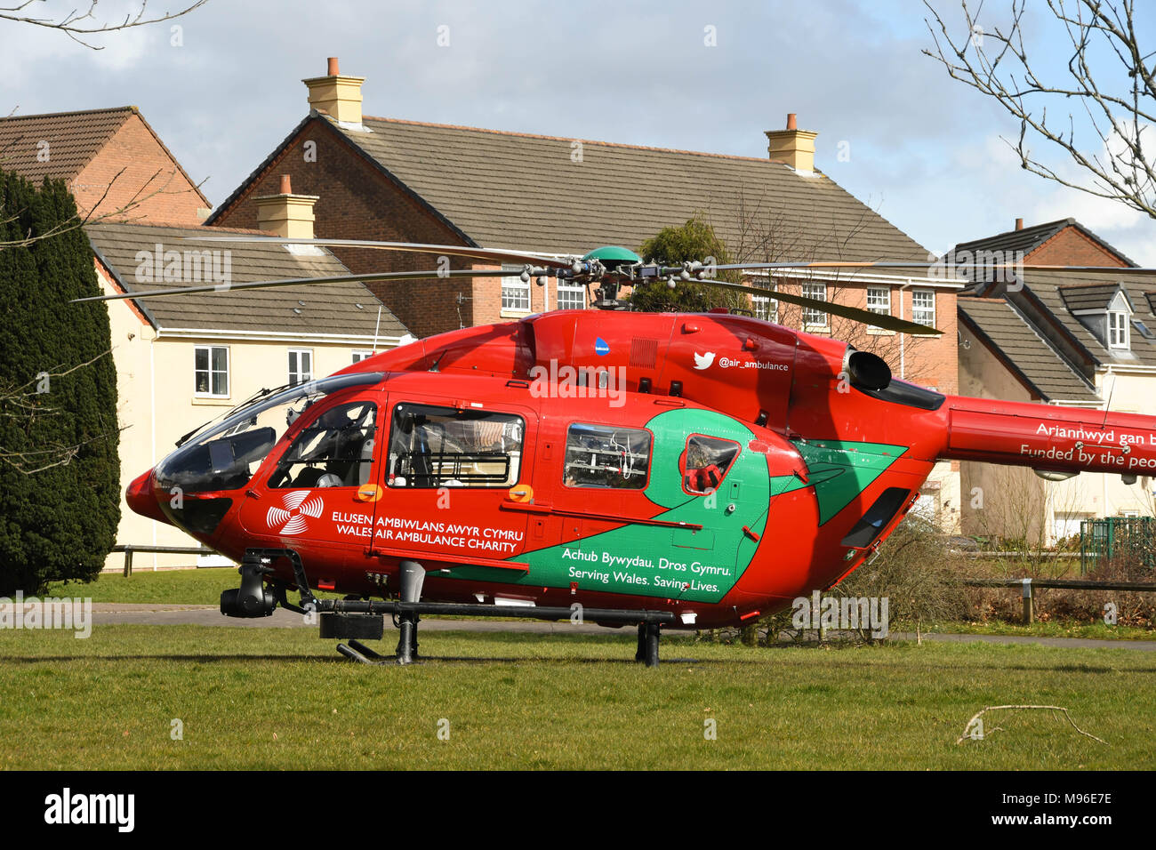 Airbus helicopter of the Wales Air Ambulance service After landing in a housing estate on an emergency mission - Stock Image