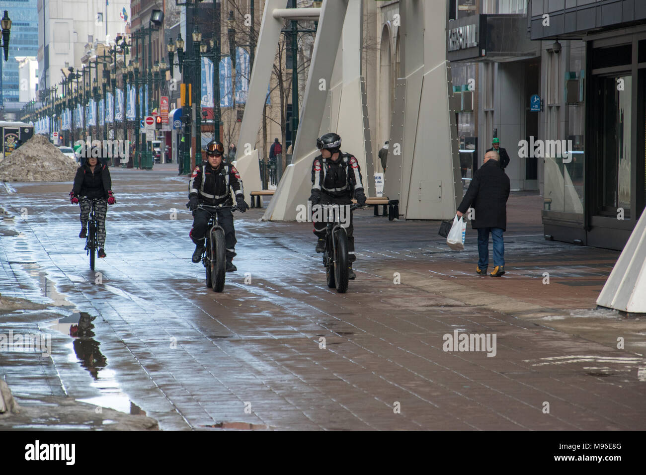 Calgary Police Services Mountain Bike Division on Trek Fat Bikes. Stephen Avenue, Calgary, Alberta, Canada - Stock Image