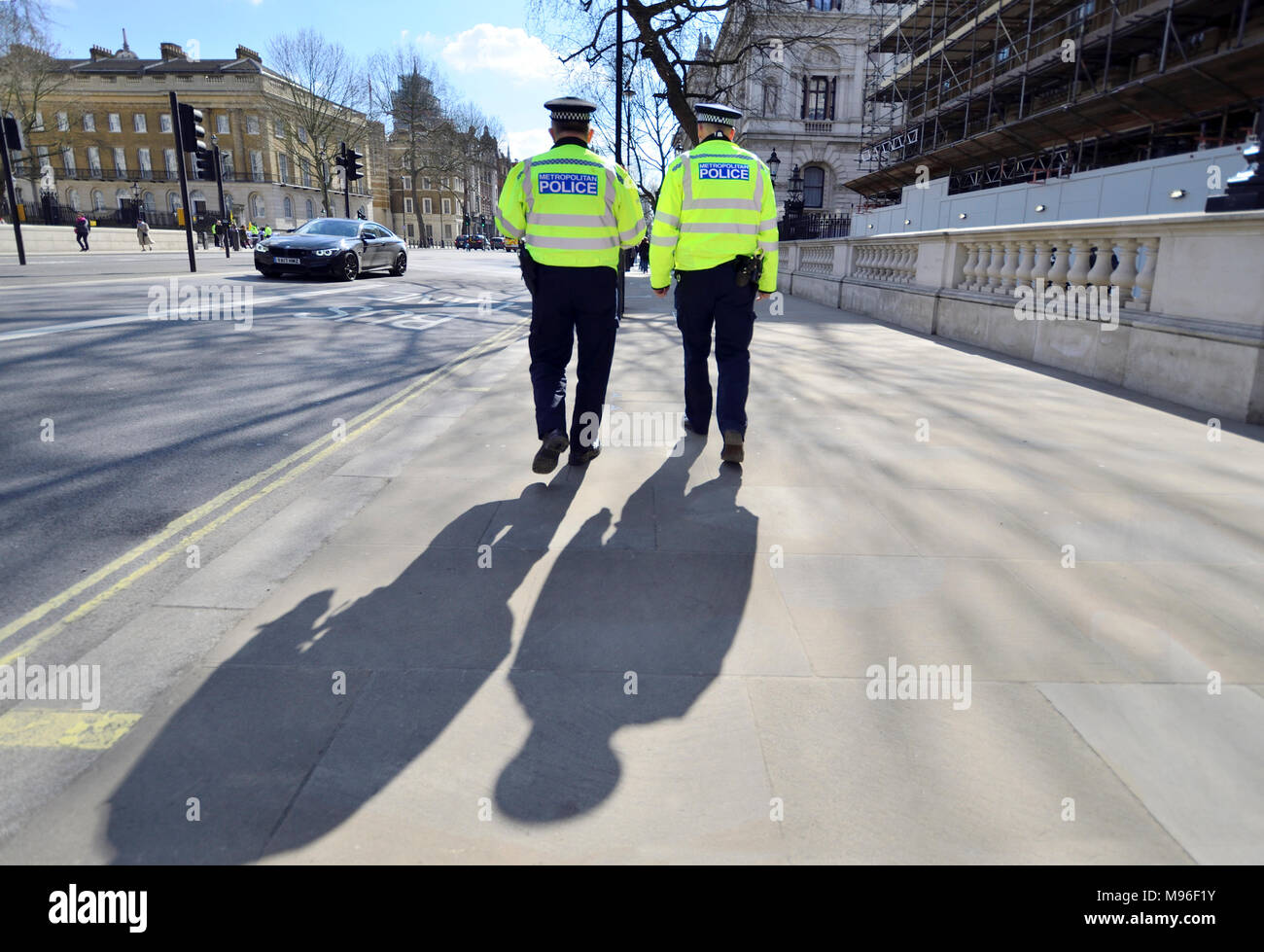 London, England, UK. Two Metropolitan Police officers in Whitehall - Stock Image
