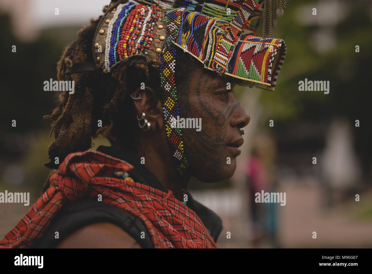 Maasai man wearing beaded headwear - Stock Image