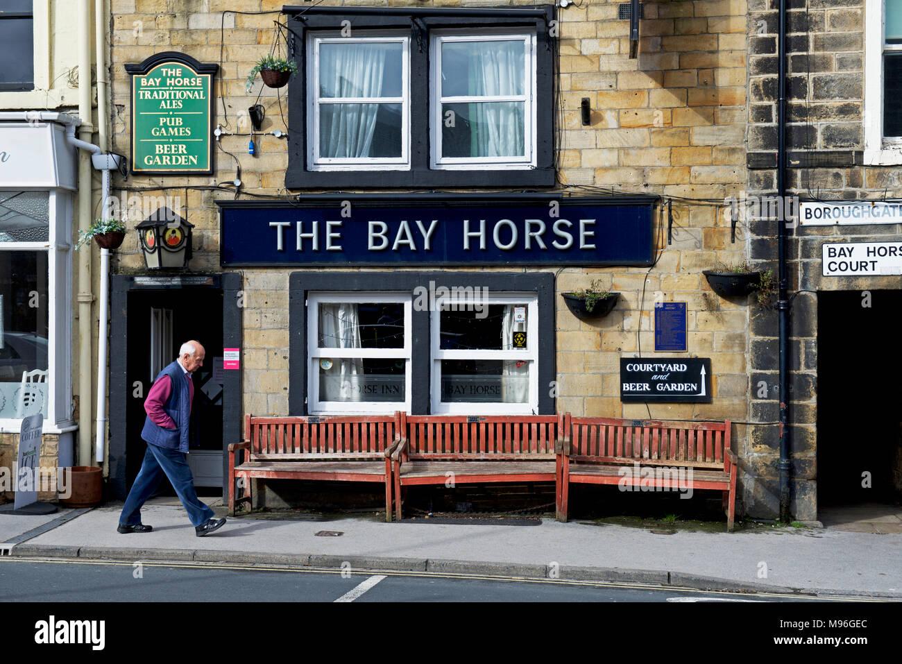 Man walking past the Bay Horse pub, Otley, West Yorkshire, England UK - Stock Image