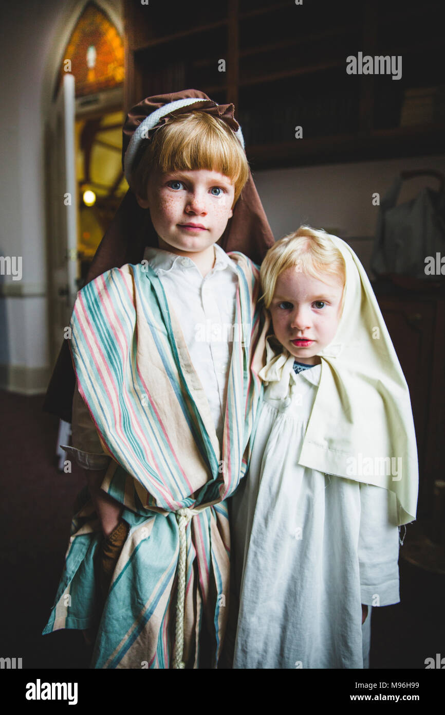 Children looking at camera in pageant costumes - Stock Image
