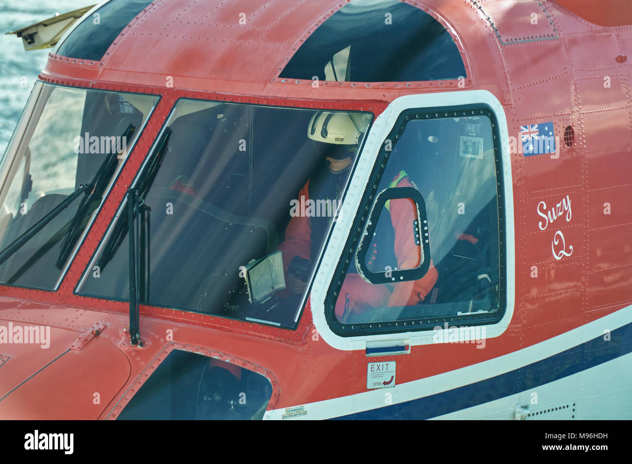 Close up of a Helicopter Pilot in the Cockpit having just landed on a Seismic Vessel in the North Sea off the Norwegian Coast. - Stock Image