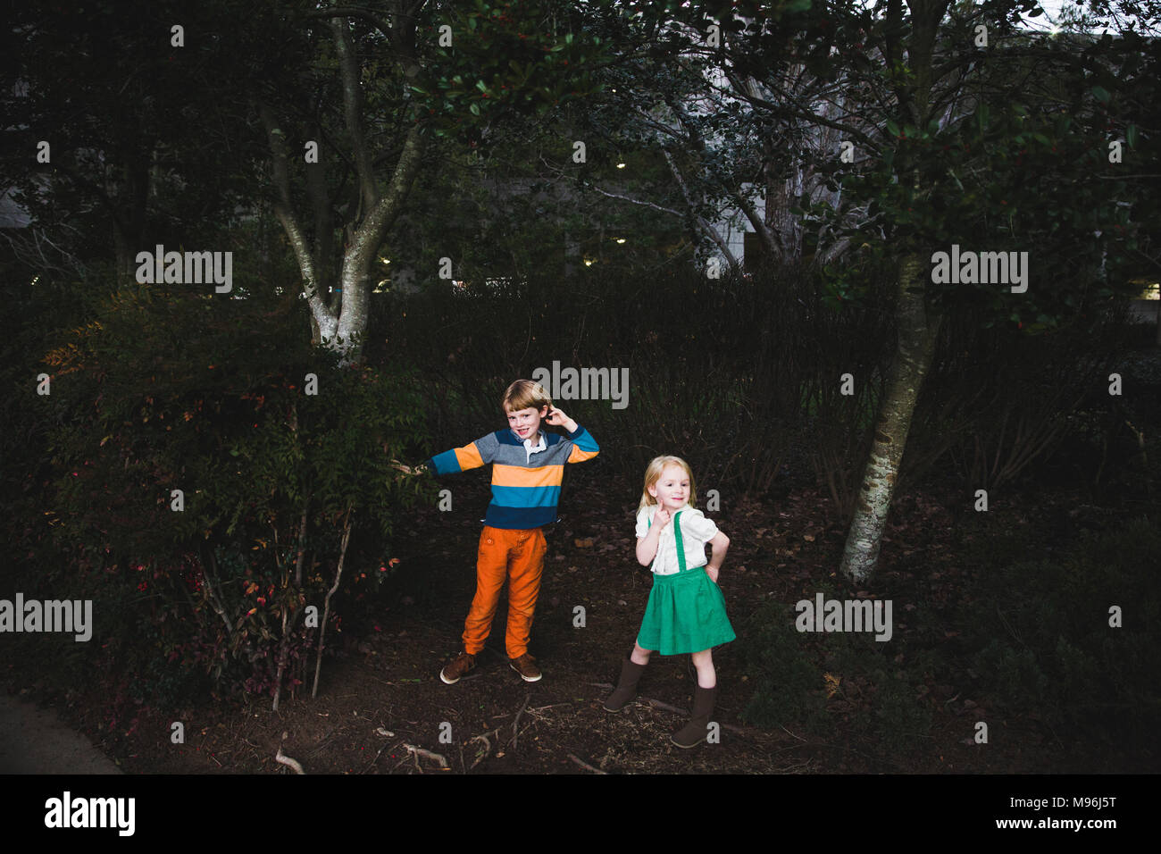 Two children playing in the woods - Stock Image