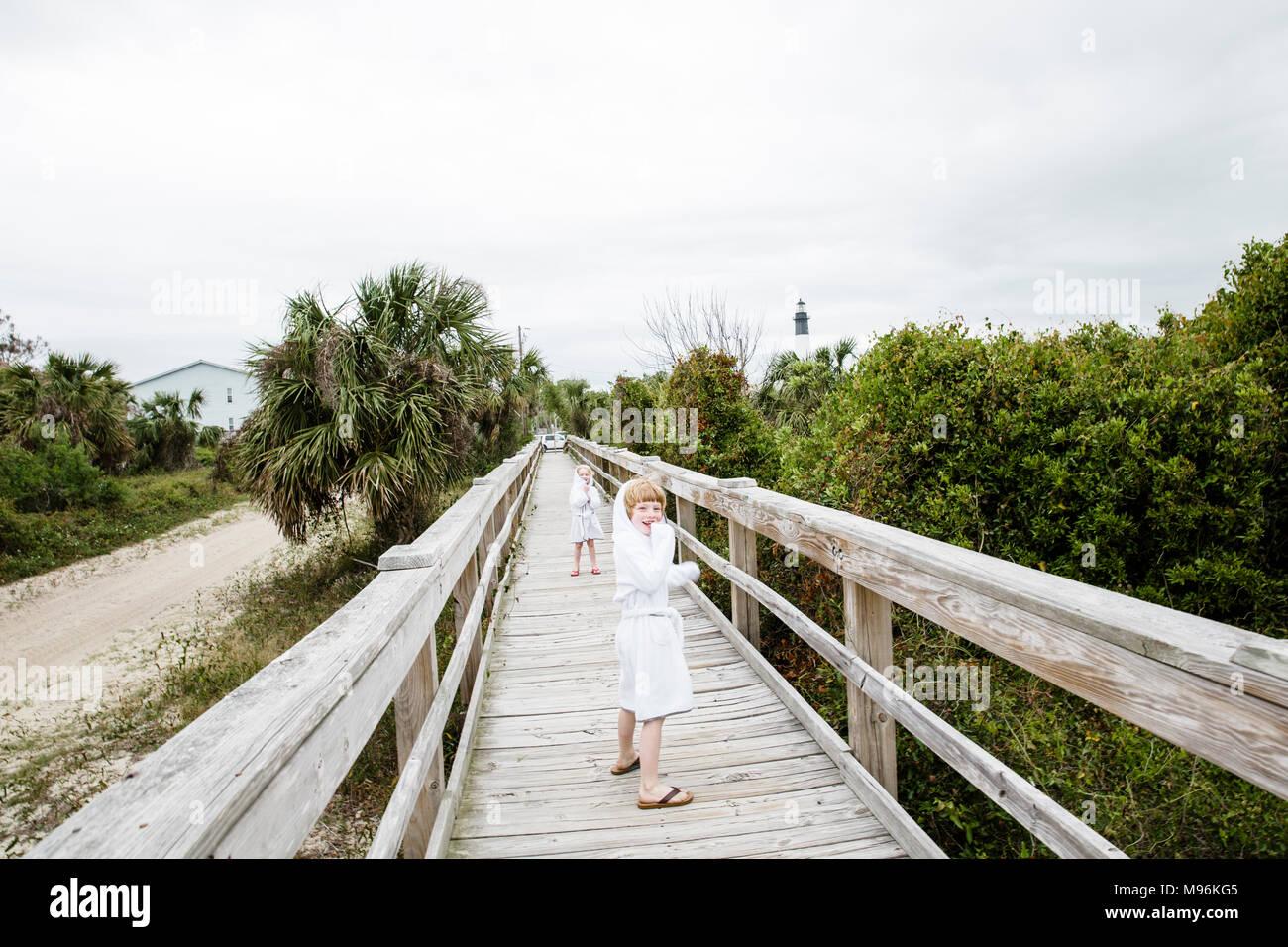 Girls standing on dock/walkway - Stock Image