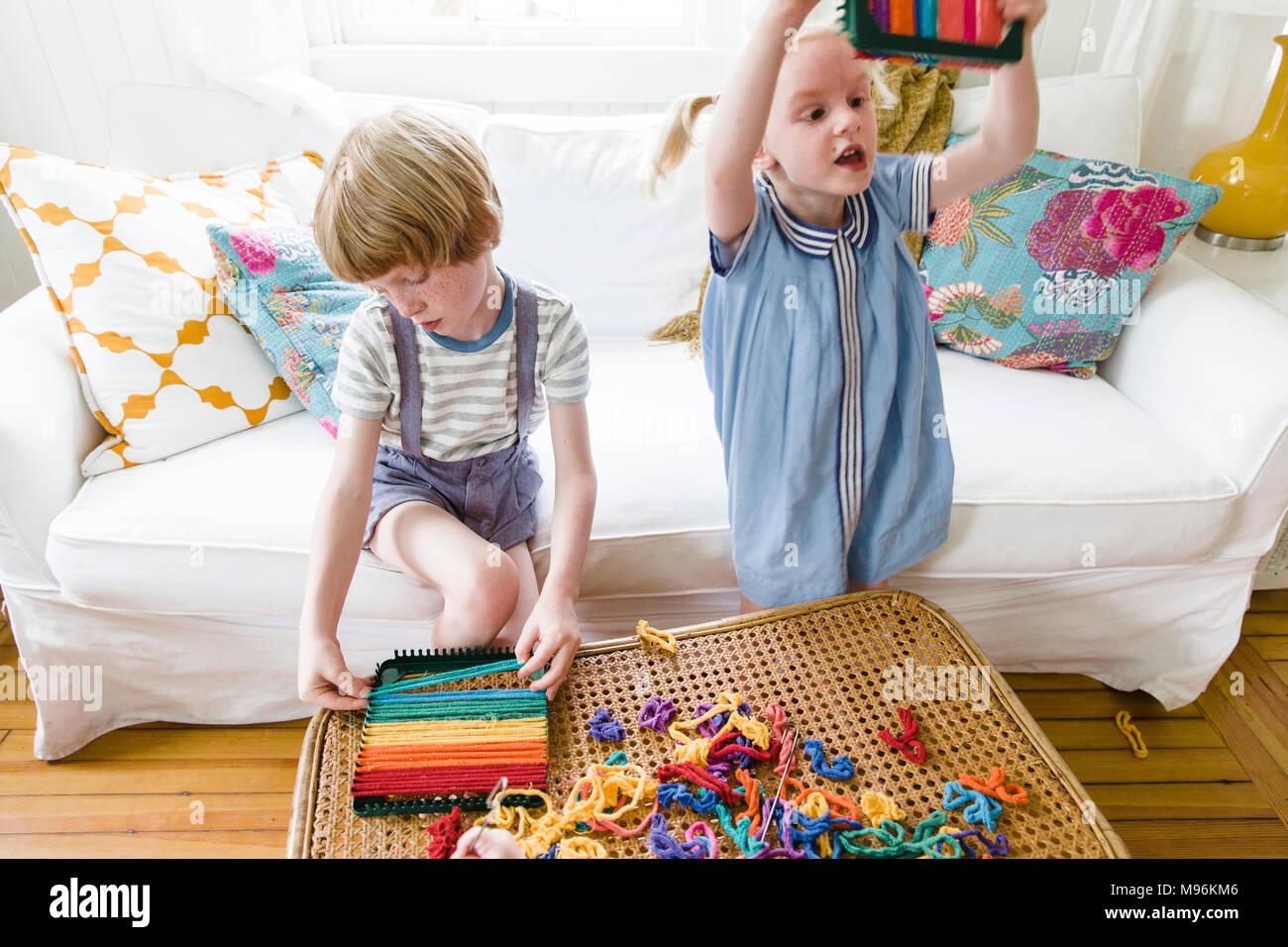 Children making potholders - Stock Image