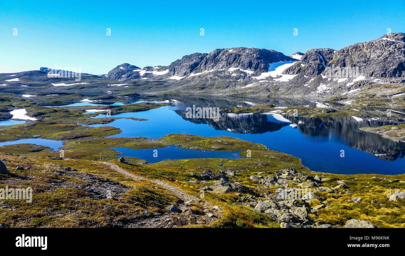 mountain range landscape with reflectiv water - Stock Image