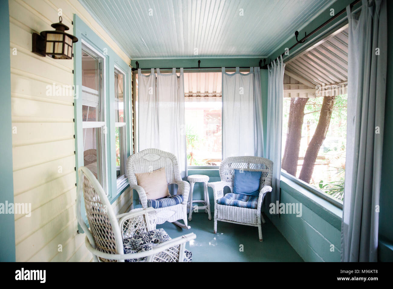 Wicker chairs on outdoor porch - Stock Image