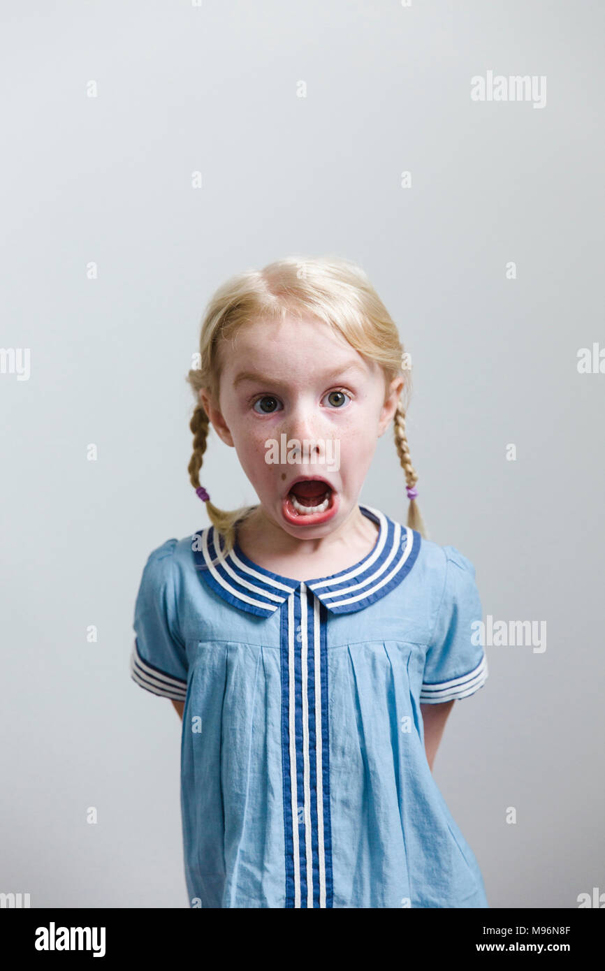 Girl pulling faces Stock Photo