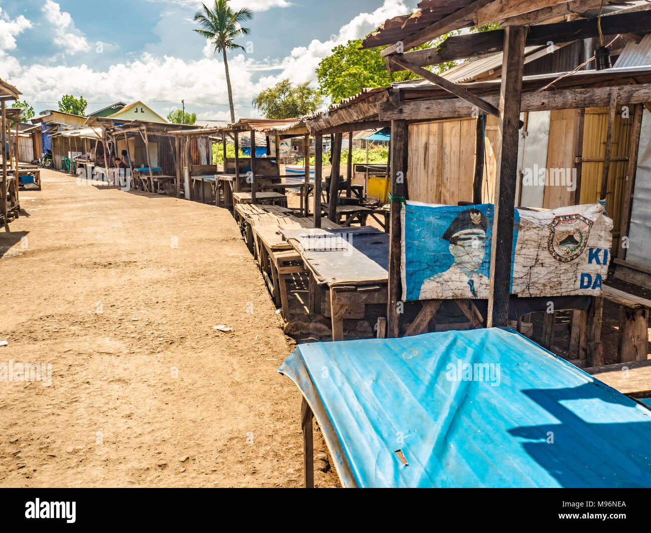 Empty traditional wooden stalls of night fish market of Gypsy Sea village in Maumere, Flores Island, Indonesia Stock Photo
