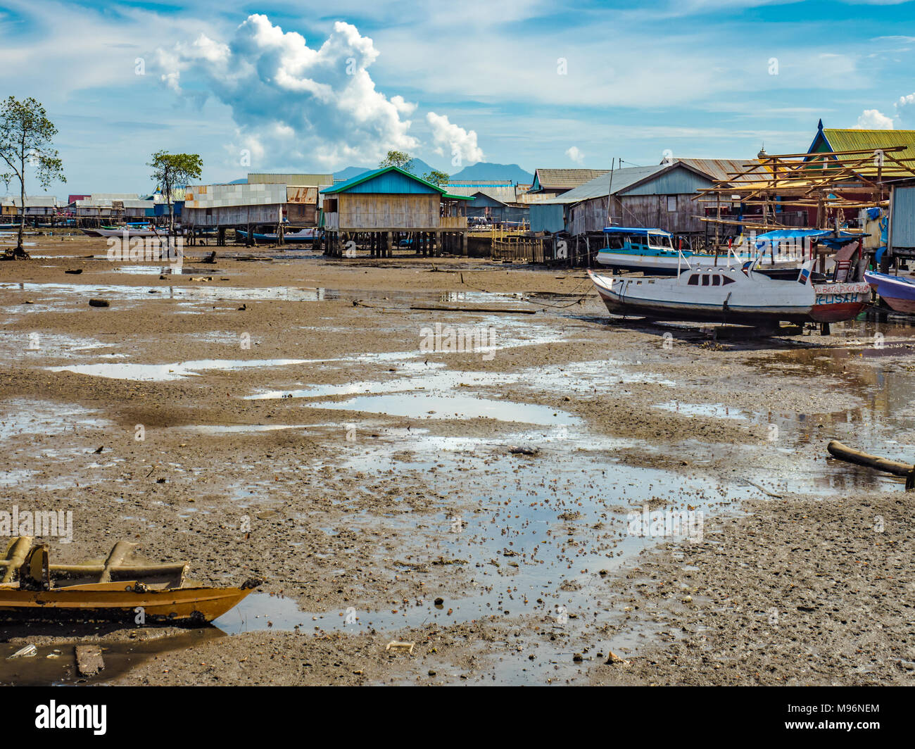 Village of Sea Gypsies during low tide. Asian traditional wooden houses on stilts. Floating houses village in Maumere, Flores Island, Indonesia Stock Photo