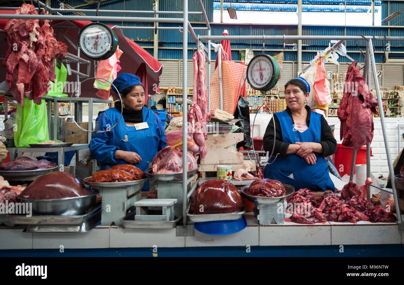 SUCRE, BOLIVIA - AUGUST 07, 2017: Unidentified bolivian women selling meat at Central Market in Sucre, Bolivia - Stock Image