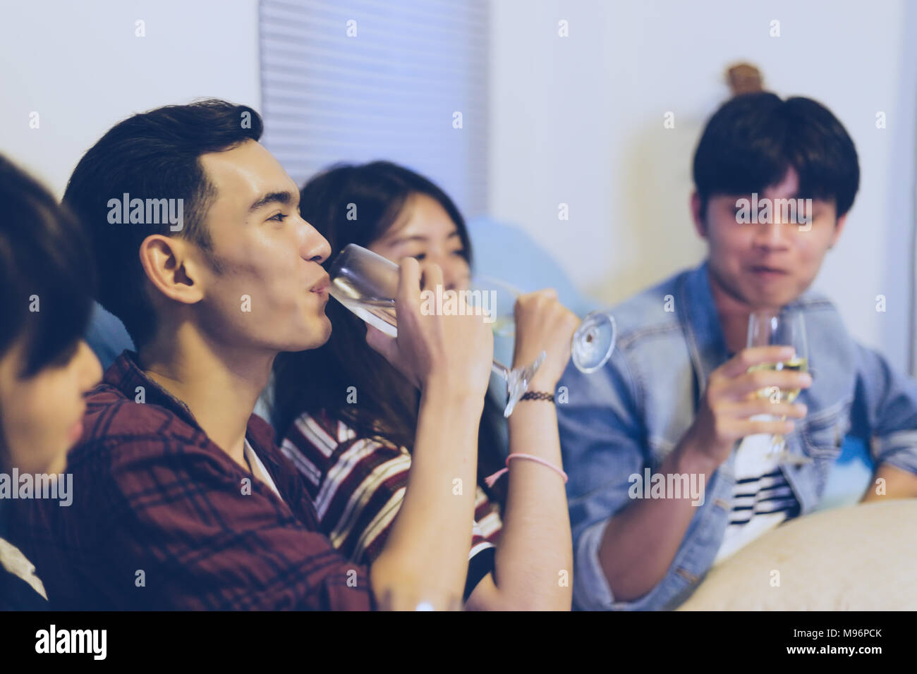 Asian group of friends having party with alcoholic beer drinks and Young people enjoying at a bar toasting cocktails.soft focus Stock Photo