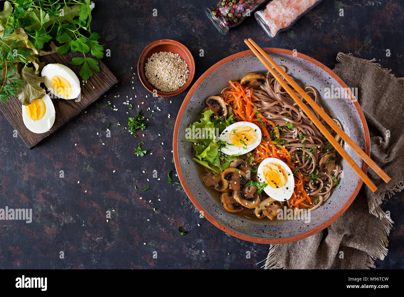 Japanese miso ramen noodles with eggs, carrot and mushrooms. Soup delicious food. Flat lay. Top view - Stock Image