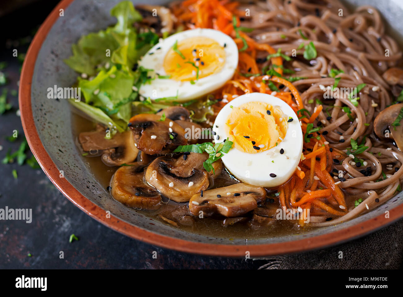 Japanese miso ramen noodles with eggs, carrot and mushrooms. Soup delicious food. - Stock Image