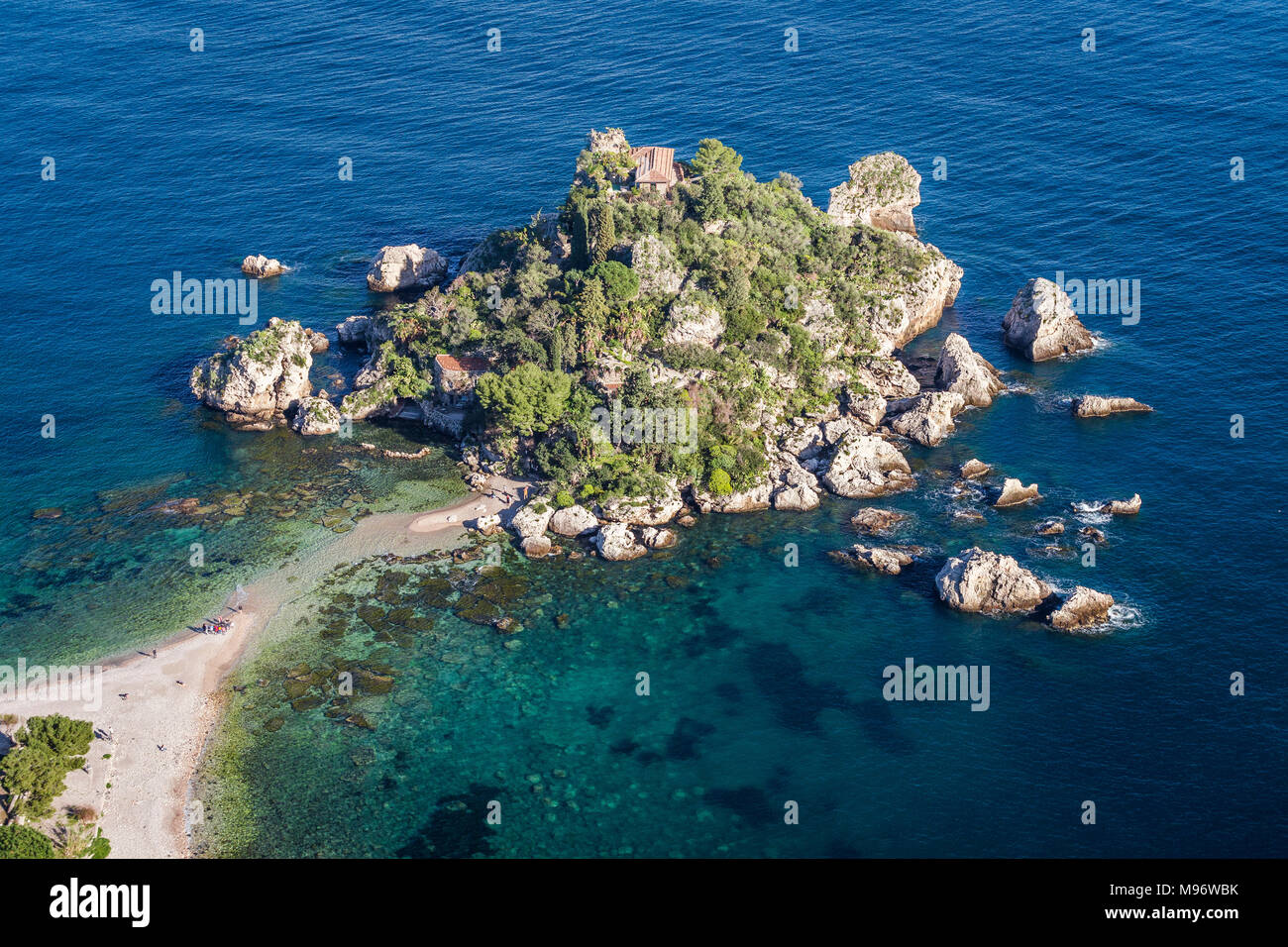 Isola Bella island in Taormina, Sicily. Sometimes the tide creates a small path with the mainland. - Stock Image