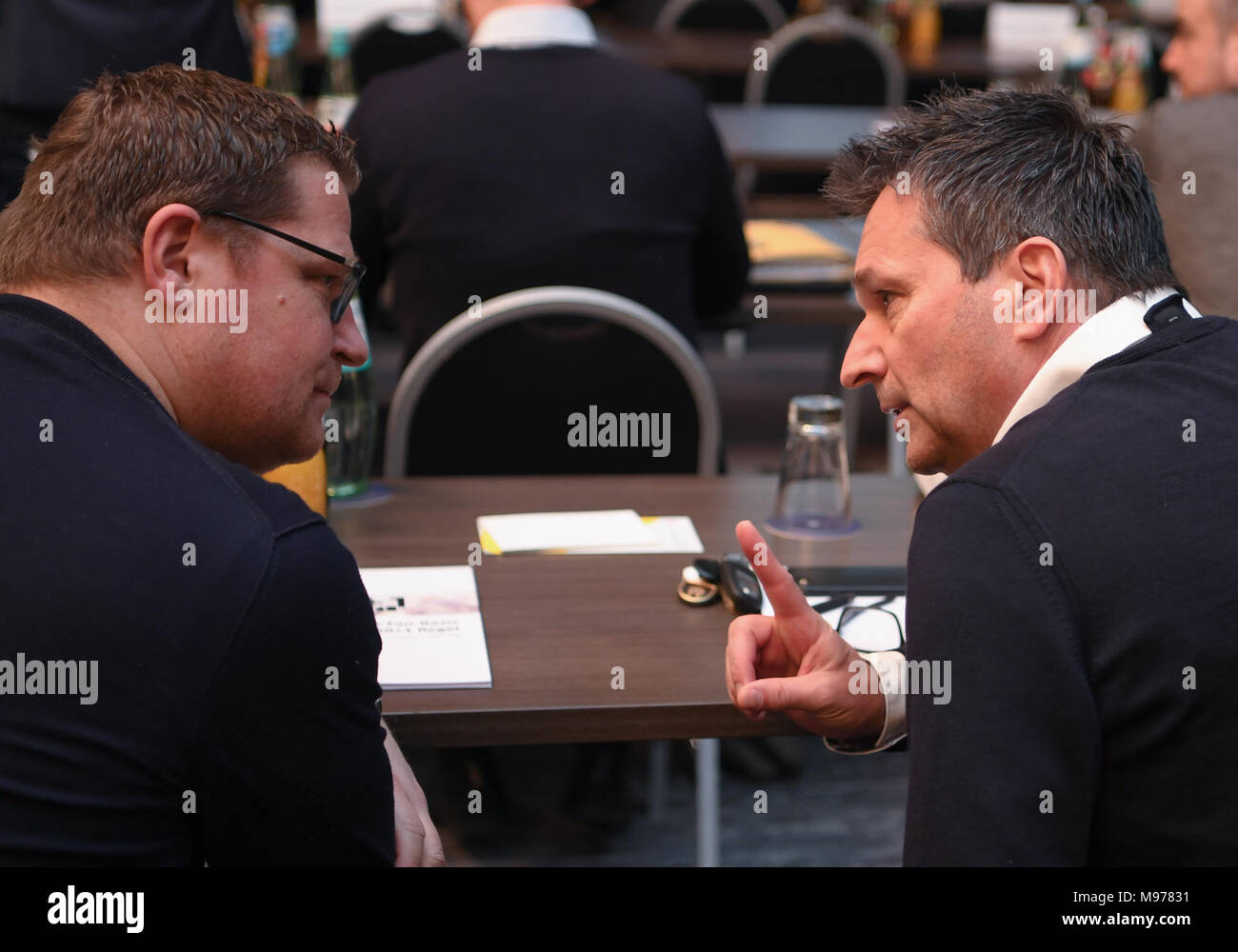 22 March 2018, Germany, Frankfurt/Main: Max Eberl (l), sports director of Borussia Moenchengladbach, and Christian Heidel, sports chairman of FC Schalke 04, speak at a members' assembly of the German Soccer League (DFL). Photo: Arne Dedert/dpa - Stock Image