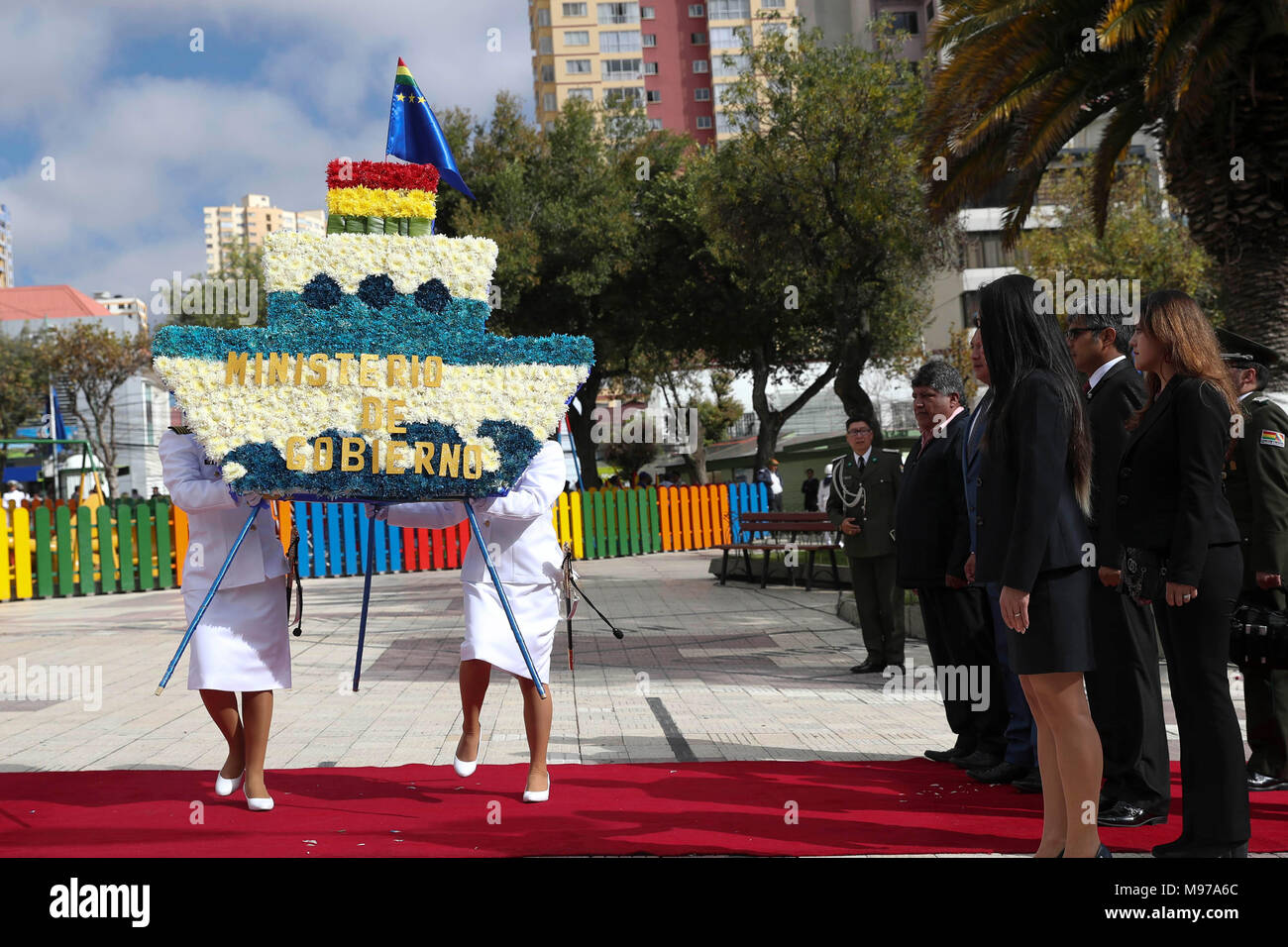 Bolivian ministers participate in a floral tribute as part of the celebrations of the Day of the Sea, during which Evo Morales invited Chile to close wounds for a 'lasting and just peace' between both countries in La Paz, Bolivia, 23 March 2018. The Bolivian President chaired the celebrations of the Day of the Sea that this year acquire a special meaning due to the development of the oral pleas at the International Court of Justice (ICJ) in The Hague for the territorial lawsuit presented by Bolivia against Chile to claim the acces to the Antofagasta sea. EFE/Martin Alipaz - Stock Image