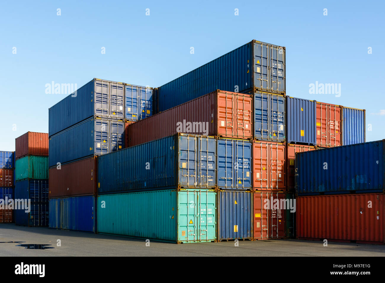 Dozens of metal containers stacked in a shipping yard on the river Marne for the supply of supermarkets in Paris. Stock Photo