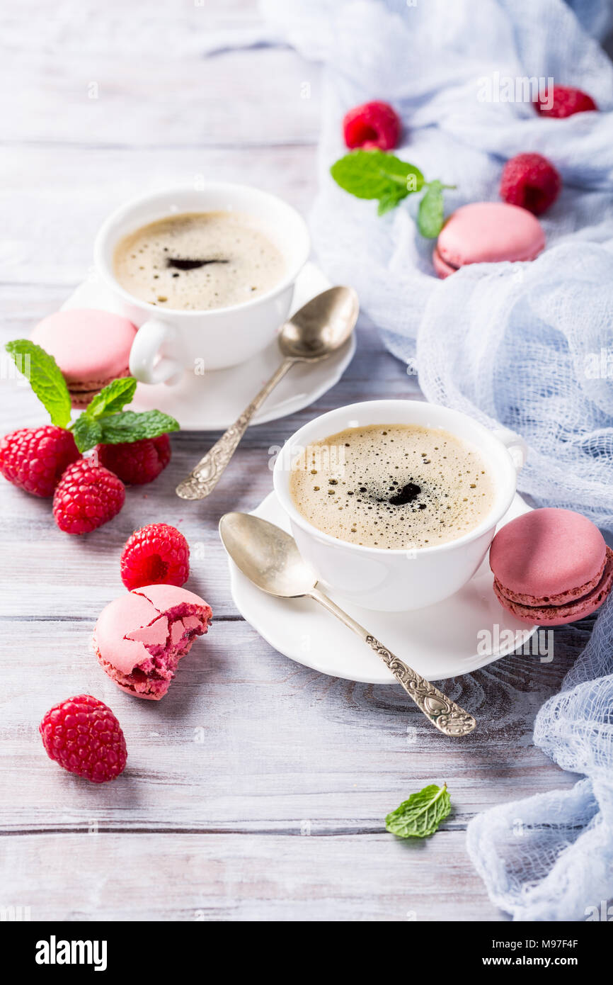 Cup of coffee with french raspberry macaroons - Stock Image