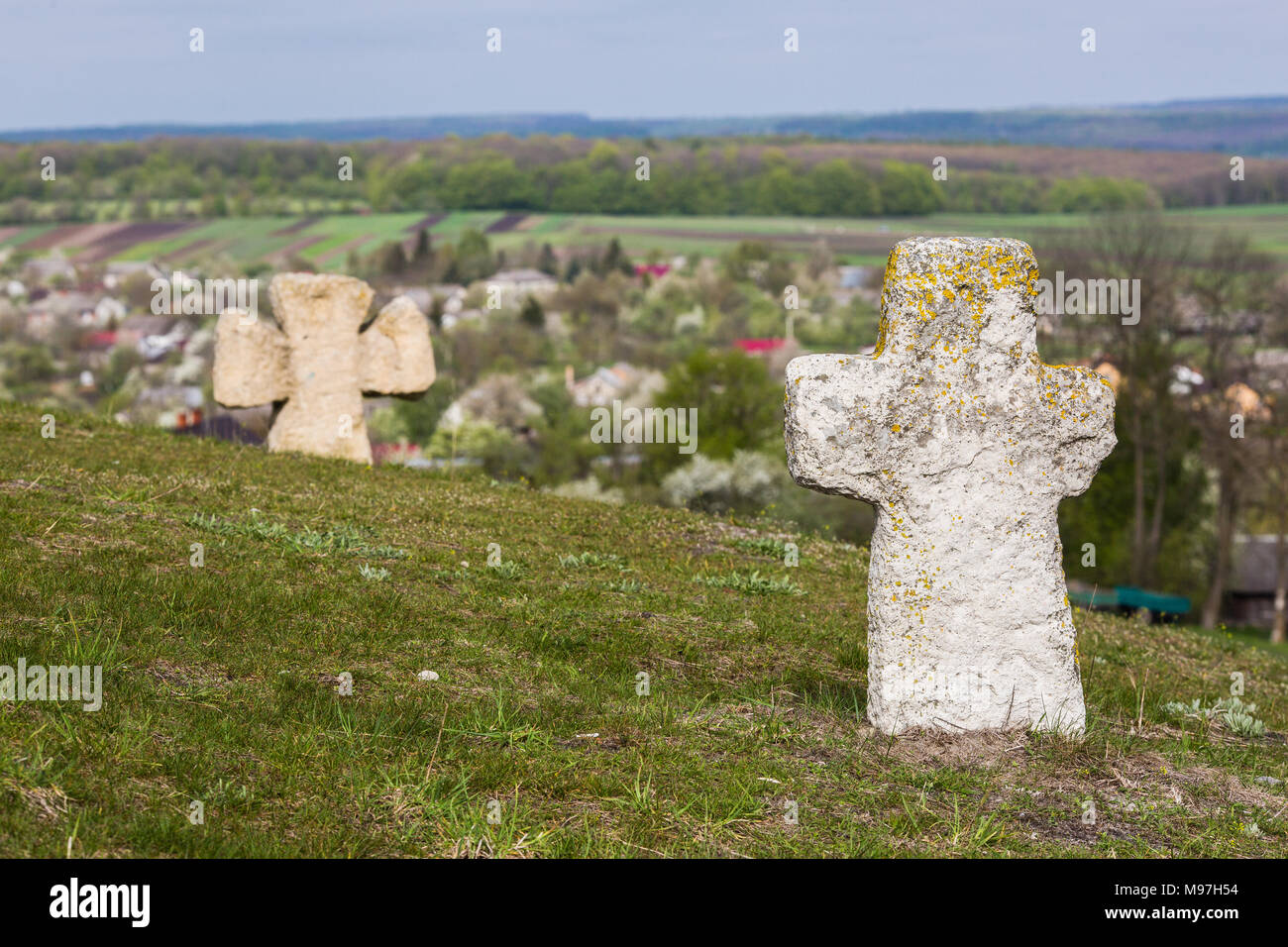 ancient slavic cross in old cemetery near famous Pidkamin Rock (Ukraine) - Stock Image