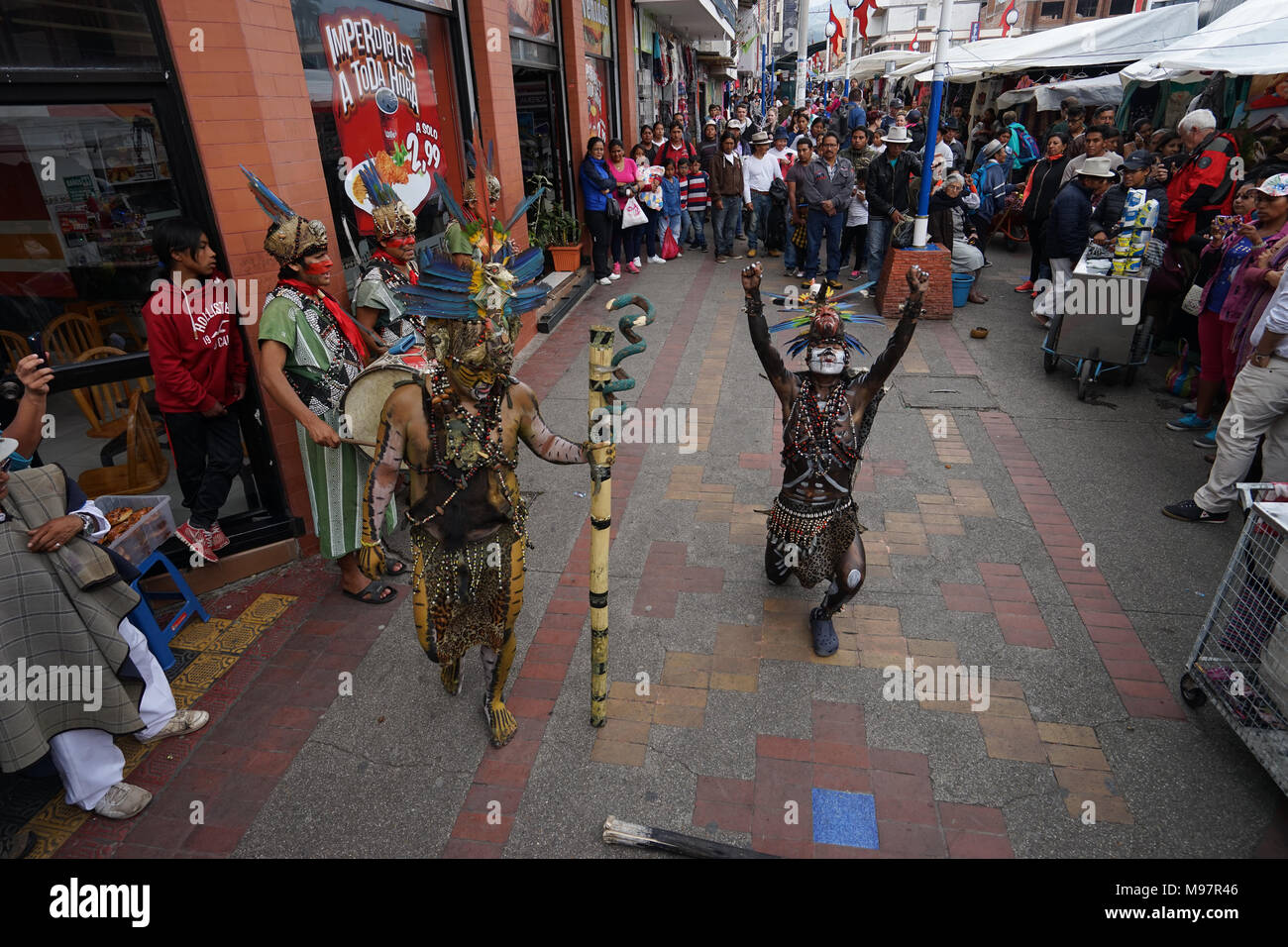 Otavalo, Ecuador- March 17, 2018: indigenous musicians and dancer performing in the artisan market - Stock Image