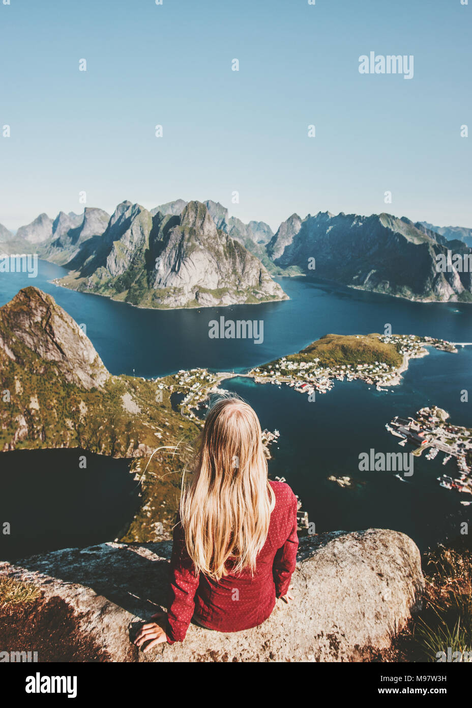 Woman enjoying aerial mountains view  travel in Norway healthy lifestyle concept adventure outdoor summer vacations Lofoten islands - Stock Image