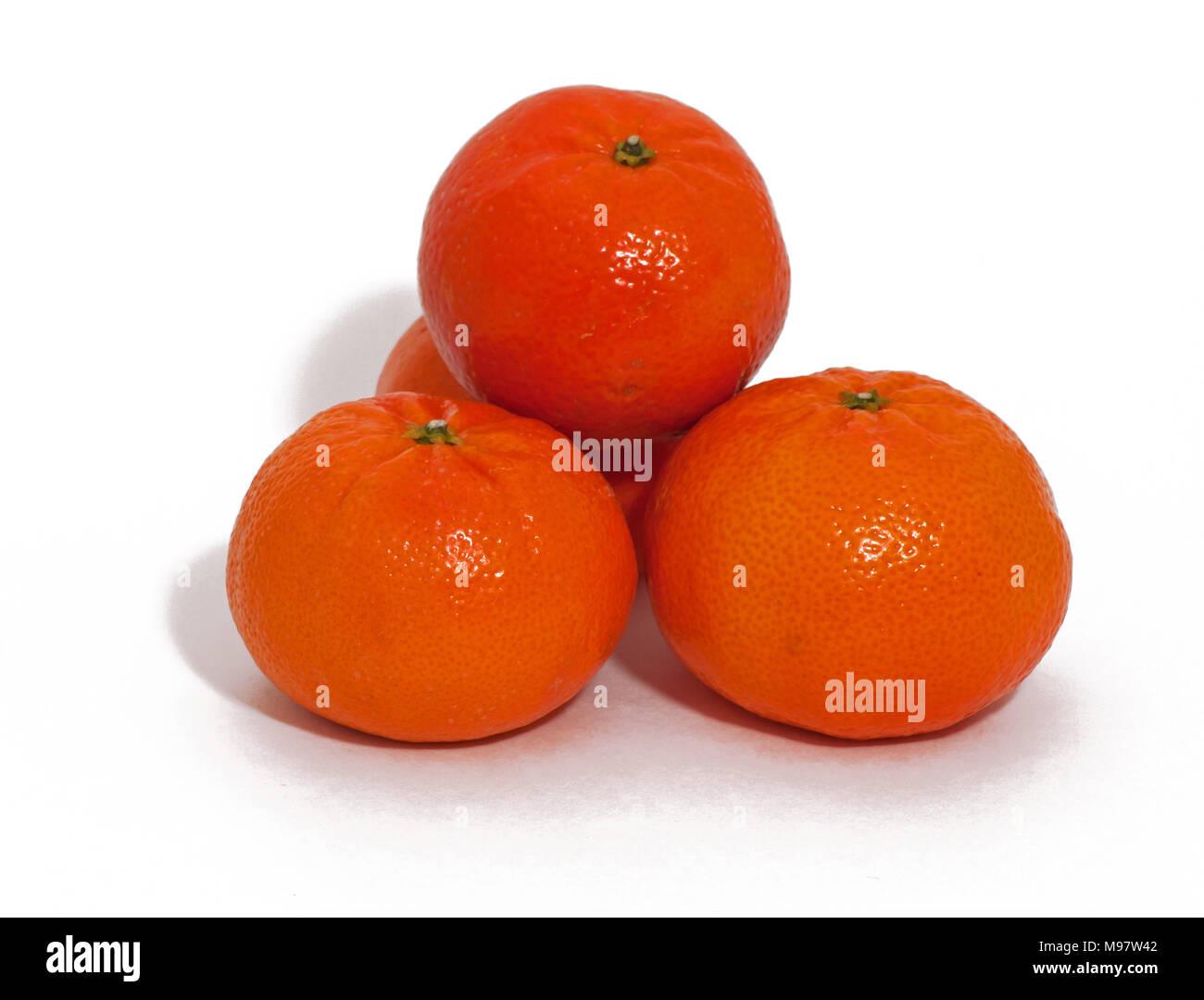 Stacked oranges with white background isolated - Stock Image