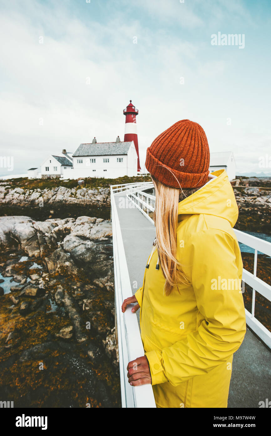 Woman sightseeing Norway lighthouse Travel Lifestyle exploring concept wanderlust vacations outdoor girl tourist standing alone - Stock Image