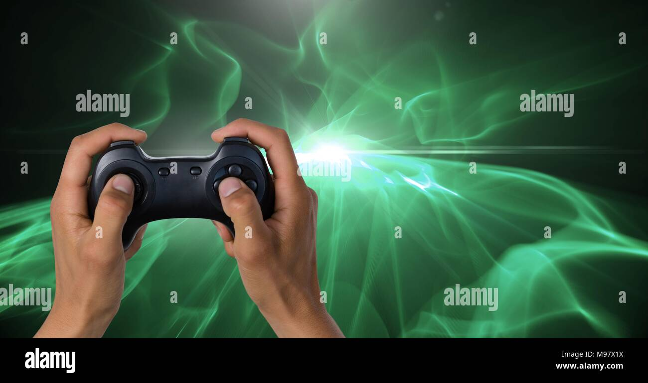Hands holding gaming controller - Stock Image