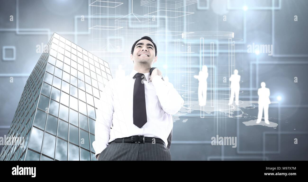 Businessman standing confidently with Tall building with  people silhouettes and shapes Stock Photo