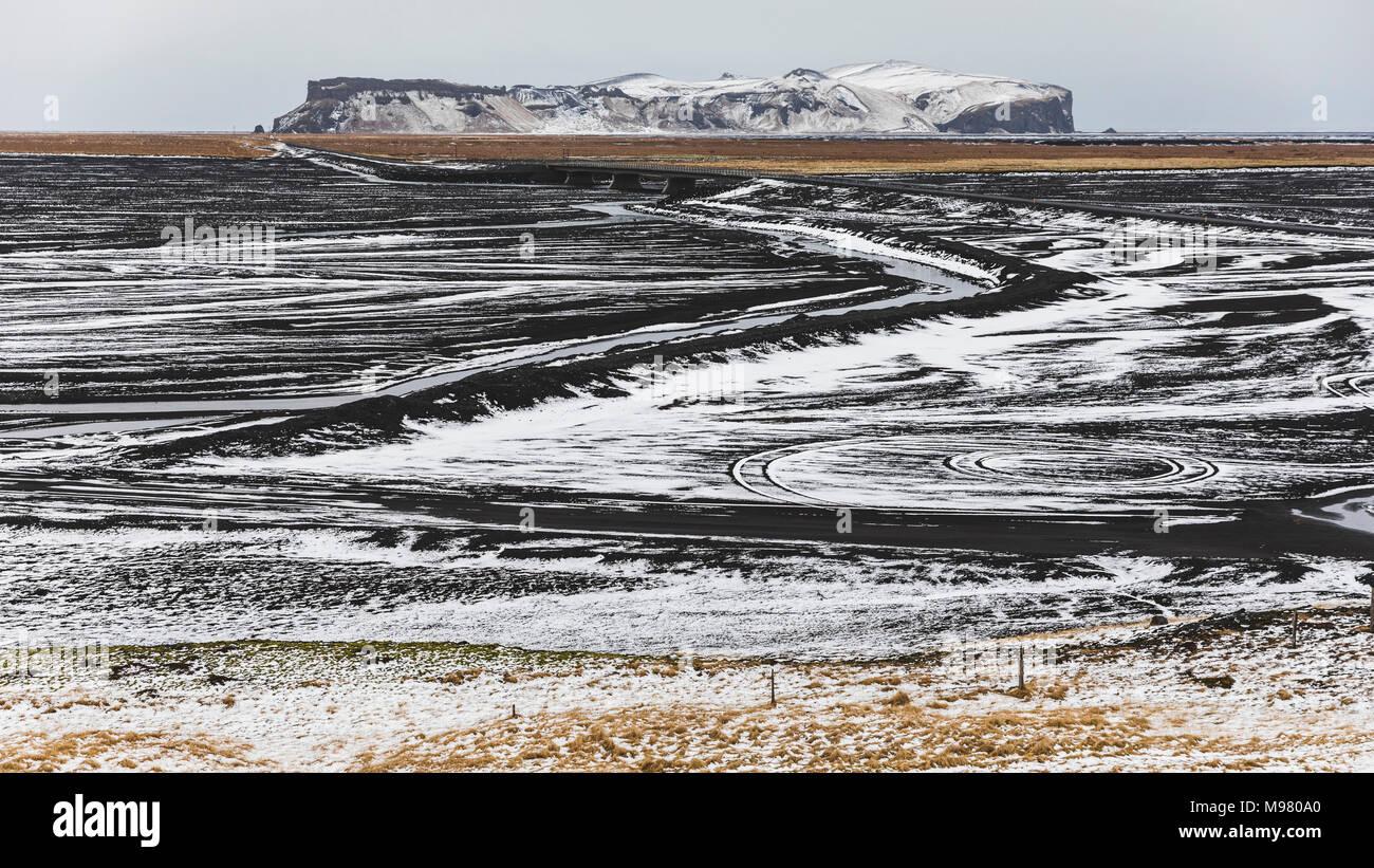 Iceland, Vik, Lava fields under snow - Stock Image