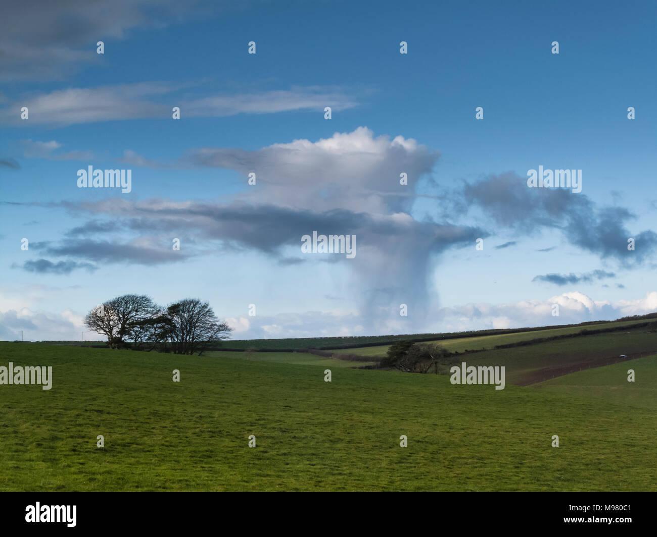 Raincloud and rain shower over Dorset landscape - Stock Image