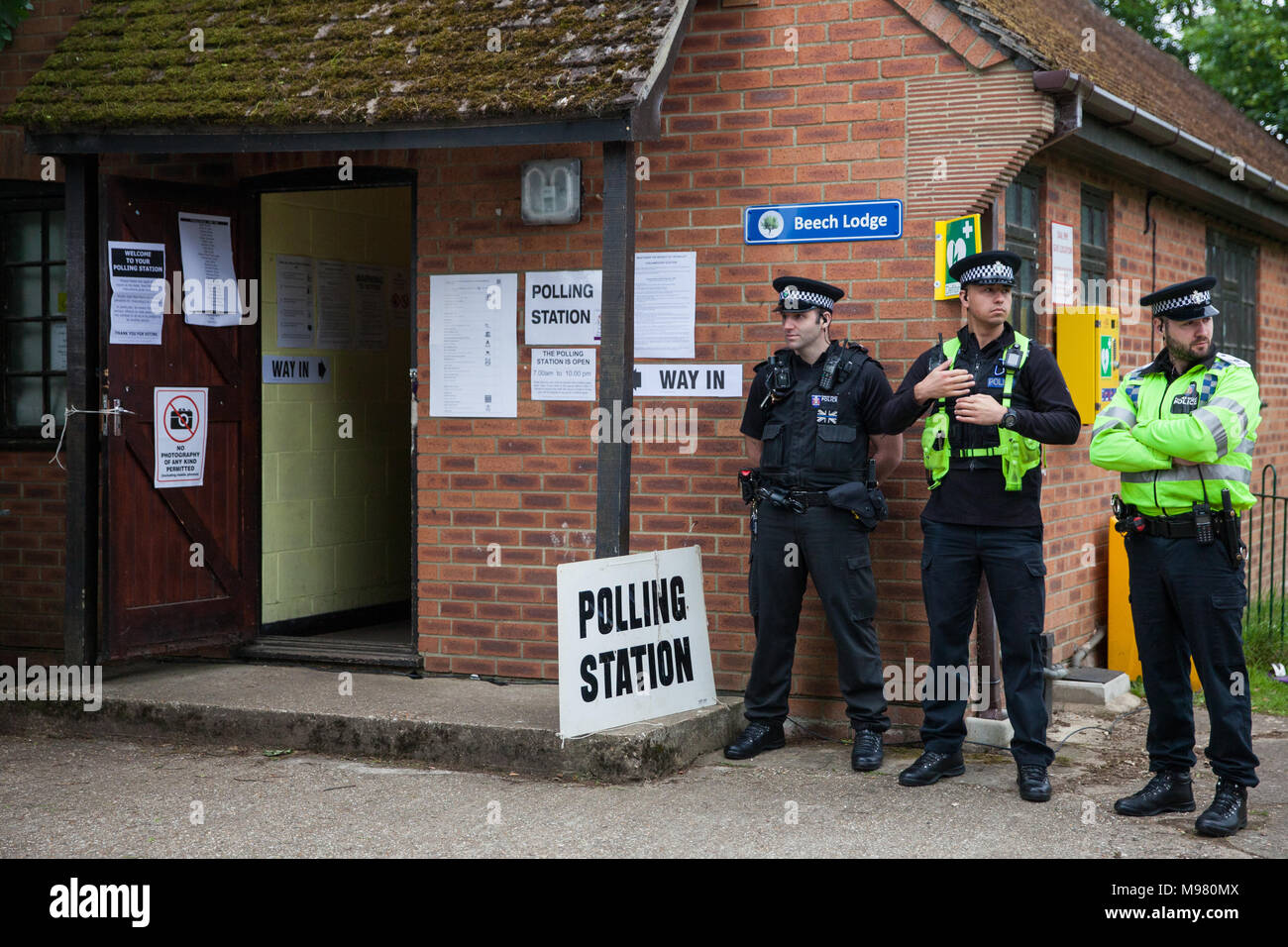 Sonning, UK. 8th June, 2017. Police officers on duty outside Prime Minister Theresa May's local polling station during the general election vote. - Stock Image