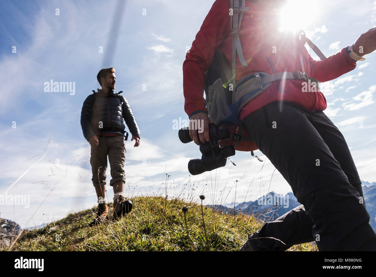 Austria, Tyrol, young couple hiking in the mountains Stock Photo