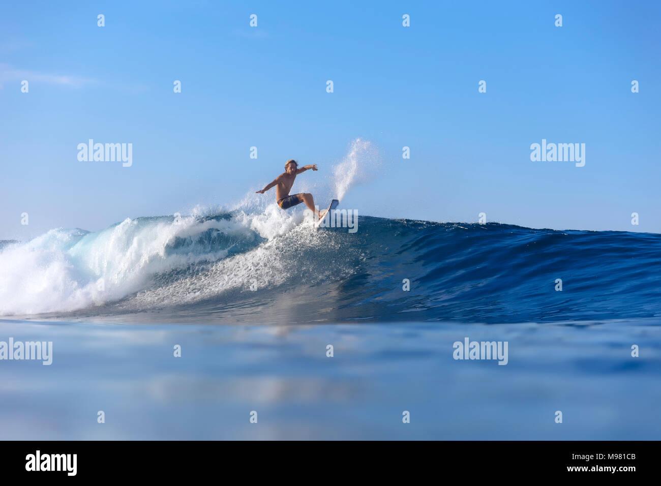 Indonesia, Sumatra, surfer on a wave - Stock Image