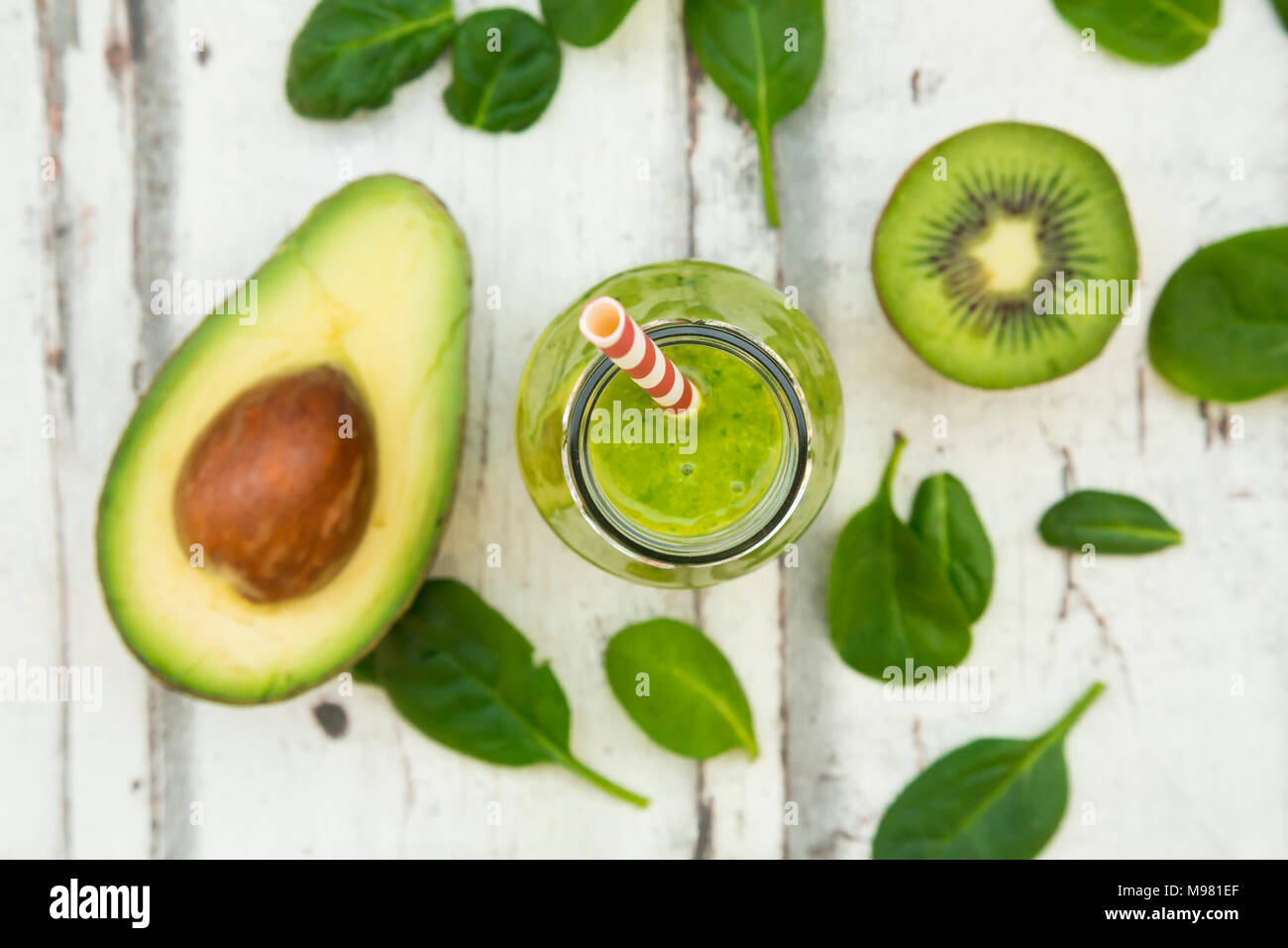 Green smoothie, detox, with avocado, baby spinach and kiwi - Stock Image