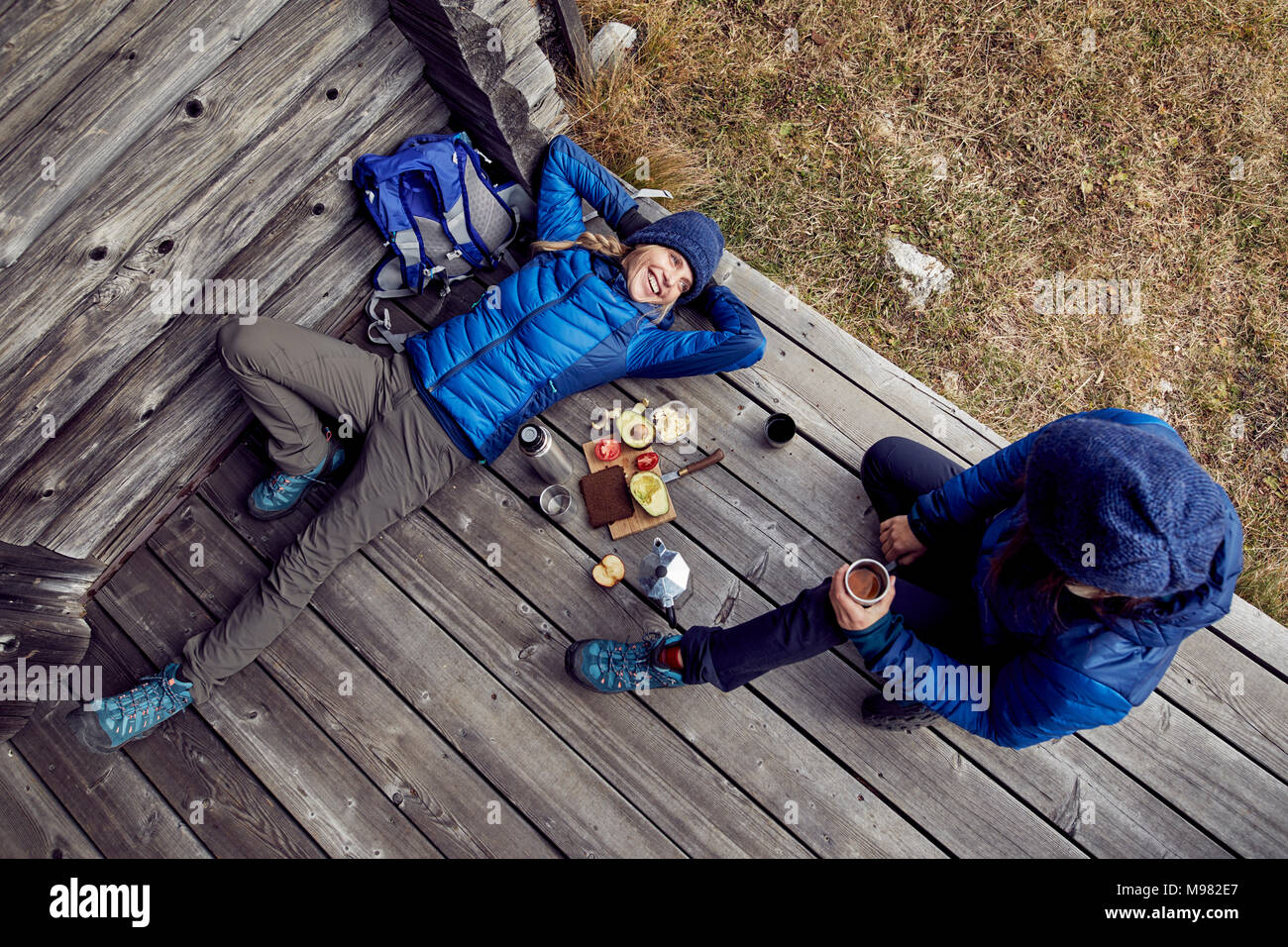 Overhead view of couple hikers having a break at mountain hut - Stock Image