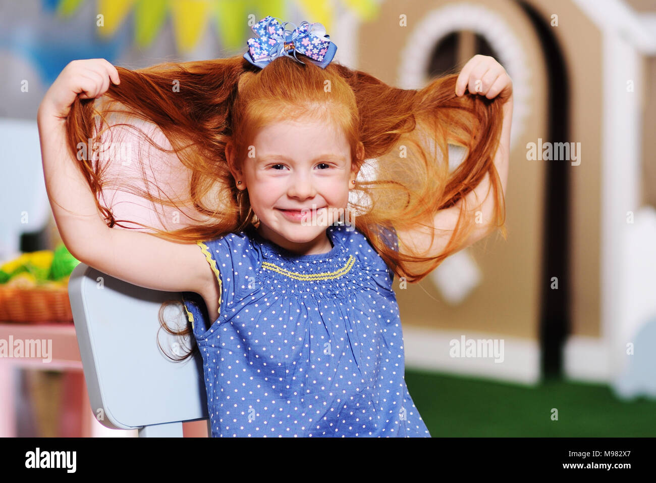 beautiful funny ginger girlr smiling and grimacing - Stock Image