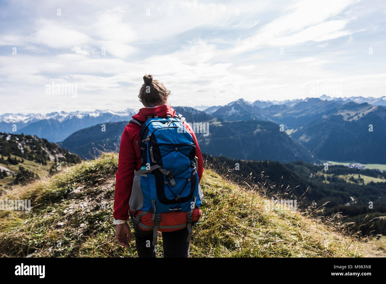 Austria, Tyrol, young woman hiking in the mountains Stock Photo